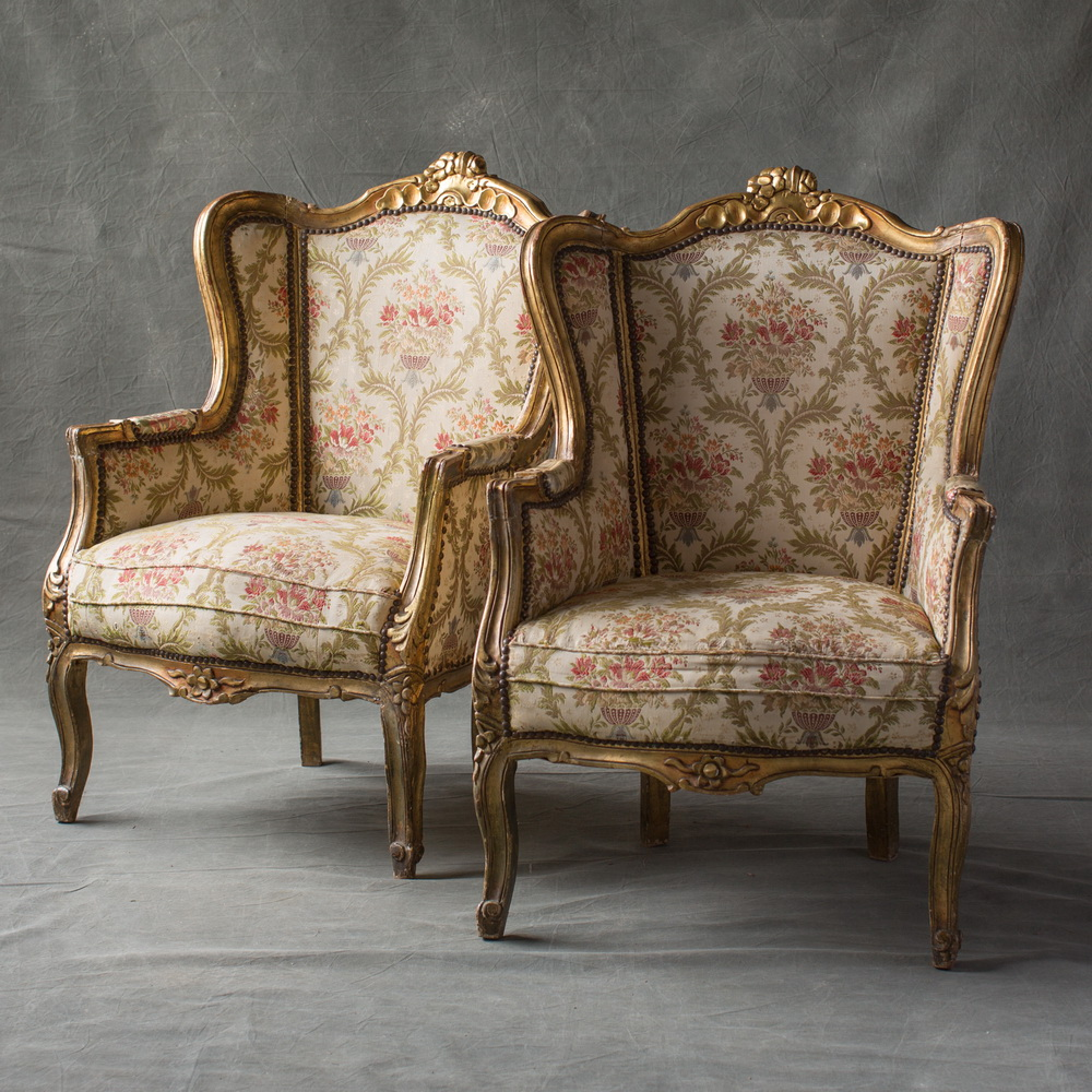 Pair of French carved and gilt winged bergere chairs in the Louis XV taste. - Pair Of French Gilt Bergere Chairs (2) « The Hudson Merchantile